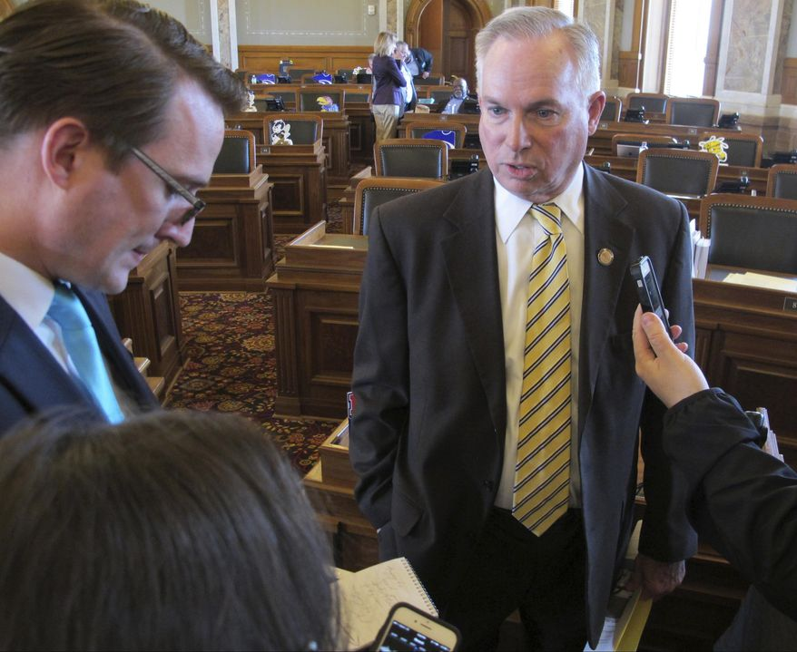 Kansas House Majority Leader Don Hineman, R-Dighton, answers questions from reporters after the House adjourns for the day at the Statehouse, Wednesday, May 3, 2017,  in Topeka, Kan. The House's GOP leaders canceled a debate on a bill that would have increased income taxes to raise more than $1 billion in new revenue over two years (AP Photo/John Hanna).