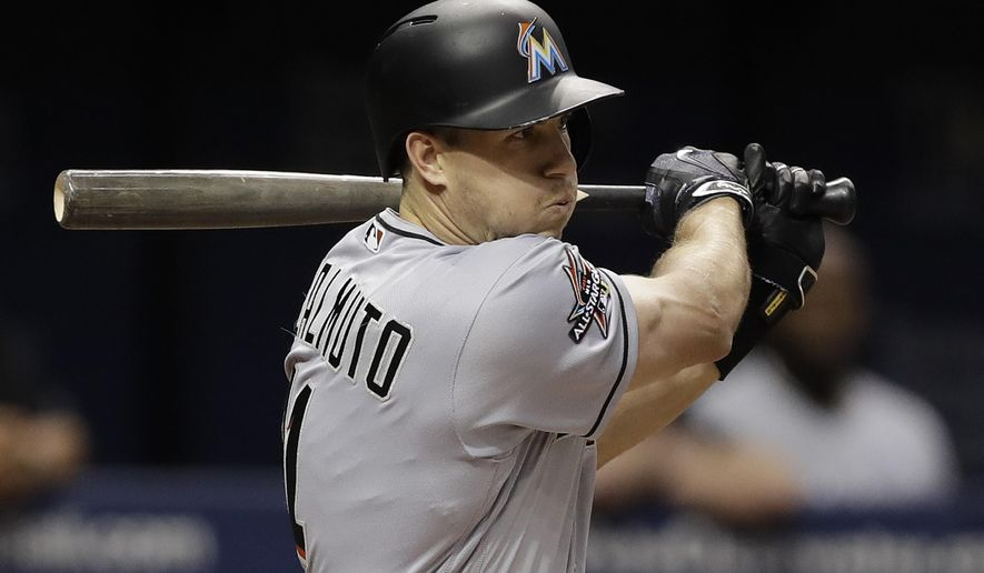 Miami Marlins' J.T. Realmuto lines a two-run single off Tampa Bay Rays relief pitcher Austin Pruitt during the sixth inning of a baseball game, Wednesday, May 3, 2017, in St. Petersburg, Fla. (AP Photo/Chris O'Meara)