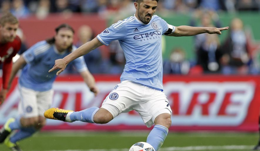 FILE - In this March 13, 2016, file photo, New York City FC forward David Villa scores a penalty kick goal against Toronto FC during the first half of an MLS soccer game at Yankee Stadium in New York. The Spanish forward agreed to extend for one year his contract with New York City FC, assuring his tie with the club through 2018. The extension was announced on Wednesday, May 3, 2017, by NYCFC. (AP Photo/Adam Hunger, File)
