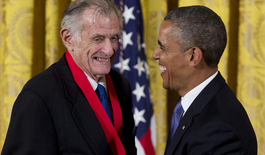 """FILE - In this July 10, 2013, file photo, President Barack Obama laughs with Frank Deford as he awards him the 2012 National Humanities Medal during a ceremony in the East Room of White House in Washington. Deford gave his final sports commentary on NPR's """"Morning Edition"""" Wednesday, ending a run of what he calls """"little homilies"""" that began in 1980.  (AP Photo/Carolyn Kaster, File)"""