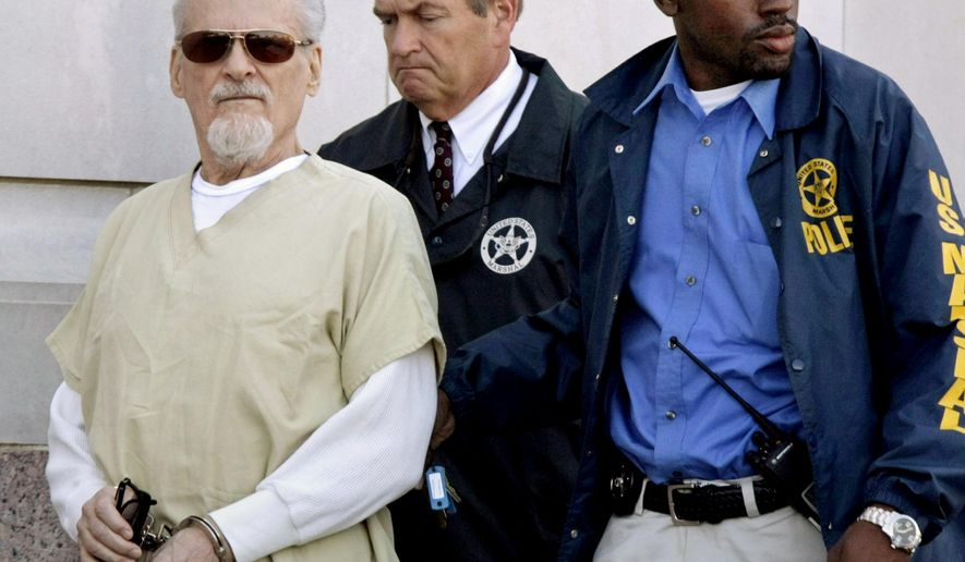 FILE - In this July 23, 2009, file photo, Tony Alamo, left, is escorted to a waiting police car outside the federal courthouse in Texarkana, Ark. Alamo, a one-time street preacher whose apocalyptic ministry grew into a multimillion-dollar network of businesses and property before he was convicted in Arkansas of sexually abusing girls he considered his wives, died in prison Tuesday, May 2, 2017. He was 82. (AP Photo/Danny Johnston, File)