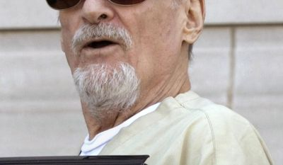 FILE - In this July 23, 2009, file photo, Tony Alamo talks to reporters as he is escorted to a waiting police car outside the federal courthouse in Texarkana, Ark. Alamo, a one-time street preacher whose apocalyptic ministry grew into a multimillion-dollar network of businesses and property before he was convicted in Arkansas of sexually abusing girls he considered his wives, has died in prison Tuesday, May 2, 2017. He was 82. (AP Photo/Danny Johnston, File)