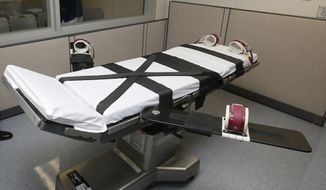 FILE - This Oct. 9, 2014 file photo shows the gurney in the the execution chamber at the Oklahoma State Penitentiary in McAlester, Okla. Oklahoma has had one of the busiest death chambers in the country for decades, executing more people per capita than any other state since the U.S. Supreme Court ruled in 1976 that death sentences could resume. But after a botched lethal injection in 2014 and drug mix-ups in two scheduled executions in 2015, the state is taking a close look at whether executions should resume at all (AP Photo/Sue Ogrocki, File)