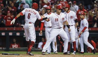 Cincinnati Reds' Billy Hamilton (6) celebrates with Devin Mesoraco (39) after hitting a three-run home run off Pittsburgh Pirates starting pitcher Jameson Taillon during the fourth inning of a baseball game, Wednesday, May 3, 2017, in Cincinnati. (AP Photo/John Minchillo)