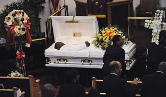 FILE - In this Wednesday, July 23, 2014 file photo, Eric Garner's body lies in a casket during his funeral at Bethel Baptist Church in the Brooklyn borough of New York. The 43-year-old black man died in July 2014 in New York City after a white officer placed him in a chokehold during an arrest for selling loose cigarettes. A grand jury declined to indict that officer, nor any others involved in the arrest. The city agreed to pay a $6 million civil settlement. (Julia Xanthos/New York Daily News via AP, Pool)