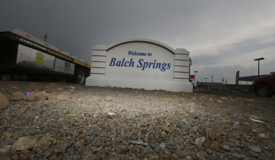 A sign sits in welcome to those entering Balch Springs, Texas, Wednesday, May 3, 2017. As the family of a black teenager slain by a white police officer calls for an indictment and more investigation, the Dallas suburb where he died faces some of the same issues with race as Ferguson, Cleveland, and other cities that have experienced high-profile police shootings of African-Americans. (AP Photo/LM Otero)