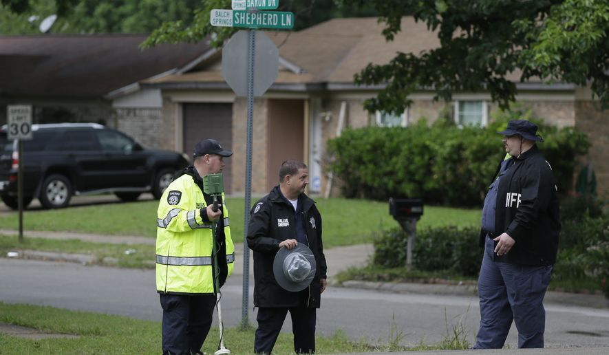Dallas County Sheriff investigators finish up a follow up search for evidence at the intersection near where Jordan Edwards was killed by a police officer in Balch Springs, Texas, Wednesday, May 3, 2017. As the family of the black teenager slain by a white police officer calls for an indictment and more investigation, the Dallas suburb where he died faces some of the same issues with race as Ferguson, Cleveland, and other cities that have experienced high-profile police shootings of African-Americans. (AP Photo/LM Otero)