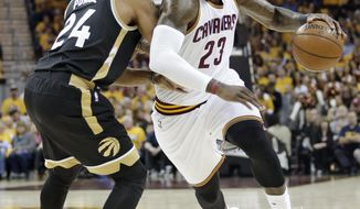Cleveland Cavaliers' LeBron James (23) drives against Toronto Raptors' Norman Powell (24) during the first half in Game 2 of a second-round NBA basketball playoff series, Wednesday, May 3, 2017, in Cleveland. (AP Photo/Tony Dejak)