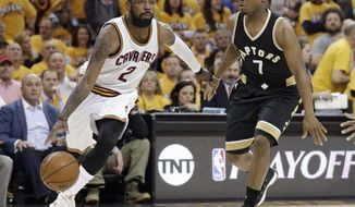 Cleveland Cavaliers' Kyrie Irving (2) drives past Toronto Raptors' Kyle Lowry (7) during the first half in Game 2 of a second-round NBA basketball playoff series, Wednesday, May 3, 2017, in Cleveland. (AP Photo/Tony Dejak)