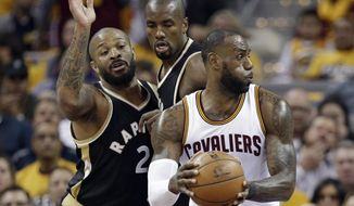 Cleveland Cavaliers' LeBron James, right, works against Toronto Raptors' P.J. Tucker, left, and Serge Ibaka during the first half in Game 2 of a second-round NBA basketball playoff series, Wednesday, May 3, 2017, in Cleveland. (AP Photo/Tony Dejak)