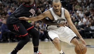 Houston Rockets' Patrick Beverley (2) defends as San Antonio Spurs' Tony Parker, right, of France moves to the basket during the second half of Game 2 in a second-round NBA basketball playoff series, Wednesday, May 3, 2017, in San Antonio. (AP Photo/Eric Gay)
