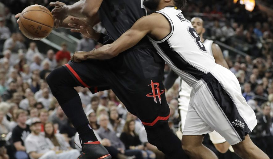 Houston Rockets center Nene Hilario, left, is fouled by San Antonio Spurs guard Patty Mills (8) during the first half of Game 1 of a second-round NBA playoff series basketball game, Monday, May 1, 2017, in San Antonio. (AP Photo/Eric Gay)