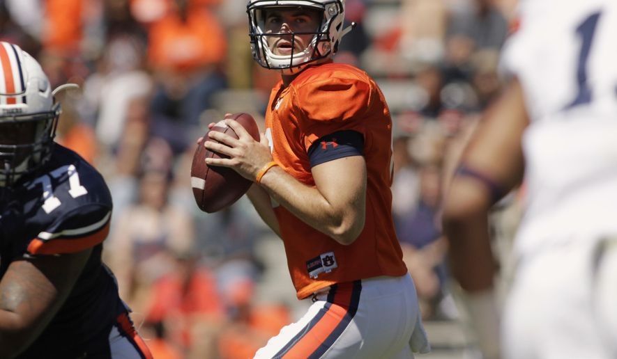 FILE - In this April 8, 2017, file photo, Auburn quarterback Jarrett Stidham looks for a receiver during Auburn's NCAA college football spring game in Auburn, Ala. Stidham, who began his college career at Baylor, went 16 of 20 for 267 yards in the spring game. (AP Photo/Todd J. Van Emst, File)