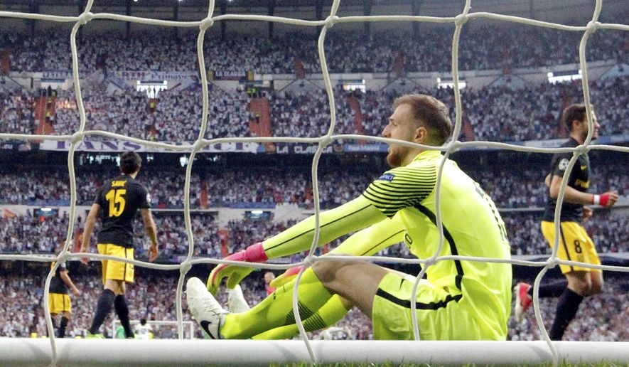 Atletico goalkeeper Jan Oblak reacts after Real Madrid's Cristiano Ronaldo scored the opening goal during the Champions League semifinals first leg soccer match between Real Madrid and Atletico Madrid at Santiago Bernabeu stadium in Madrid, Spain, Tuesday May 2, 2017. (AP Photo/Daniel Ochoa de Olza)