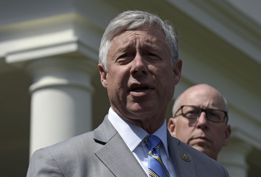 Rep. Fred Upton, R-Mich., left, speaks to reporters outside the White House in Washington, Wednesday, May 3, 2017, following a meeting with President Donald Trump on health care reform. Rep. Greg Walden, R-Ore. is at right. (AP Photo/Susan Walsh)