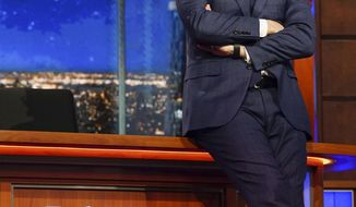 "In this Feb. 22, 2017 photo released by CBS, host Stephen Colbert appears on the set of ""The Late Show with Stephen Colbert,"" in New York. Colbert will reunite with his former Comedy Central cast members Jon Stewart, Samantha Bee, John Oliver, Ed Helms and Rob Corddry for a special episode airing Tuesday, May 9. (Gail Schulman/CBS via AP)"