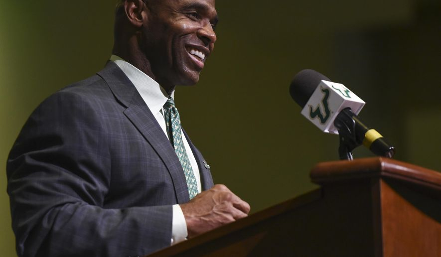 FILE - In this Dec. 15, 2016, file photo, South Florida's new football coach, Charlie Strong, smiles during a news conference in Tampa, Fla. A judge presiding over the first appearance of a South Florida football player accused of sexual battery not only had harsh words for the athlete in court, but challenged Strong's leadership of the program. Circuit Judge Margaret Taylor of Hillsborough County told defensive end LaDarrius Jackson during a hearing Wednesday, May 3, 2017, that she is a USF graduate who's ``embarrassed and ashamed'' in the wake of two separate arrests involving members of the team since March. (Andres Leiva/The Tampa Bay Times via AP, File)