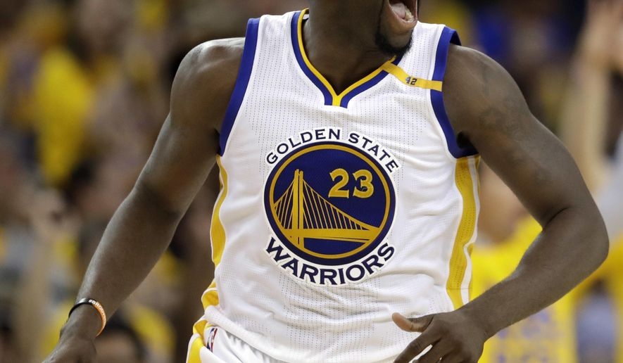 FILE - In this May 2, 2017, file photo, Golden State Warriors' Draymond Green (23) reacts to making a 3-point basket against the Utah Jazz during the second half in Game 1 of an NBA basketball second-round playoff series, in Oakland, Calif. Green has taken his trash-talking to another level this postseason right along with his defense. They go hand in hand, and he pushes it right to the limit _ to the delight of Kevin Durant and his teammates who are fueled by his ferocity, not to mention his 19 blocks in five playoff games so far. (AP Photo/Marcio Jose Sanchez, File)