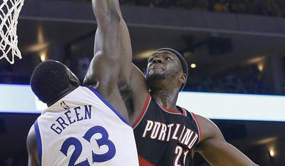 FILE - In this April 16, 2017, file photo, Golden State Warriors forward Draymond Green (23) blocks a shot attempt by Portland Trail Blazers forward Noah Vonleh during the second half of Game 1 of a first-round NBA basketball playoff series in Oakland, Calif. Green has taken his trash-talking to another level this postseason right along with his defense. They go hand in hand, and he pushes it right to the limit _ to the delight of Kevin Durant and his teammates who are fueled by his ferocity, not to mention his 19 blocks in five playoff games so far. (AP Photo/Jeff Chiu, File)