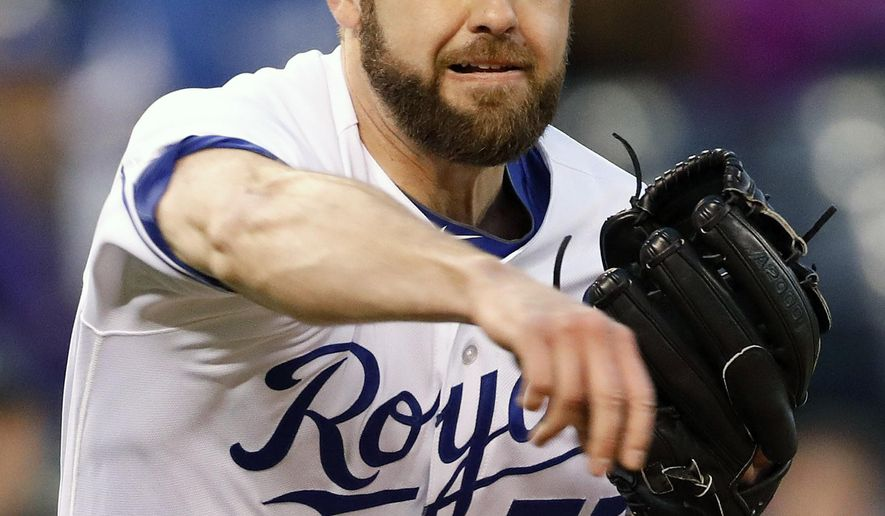 Kansas City Royals pitcher Nathan Karns throws to first base after fielding a hit by Chicago White Sox batter Melky Cabrera in the fourth inning of a baseball game at Kauffman Stadium in Kansas City, Mo., Wednesday, May. 3, 2017. Cabrera was safe on the play. (AP Photo/Colin E. Braley)