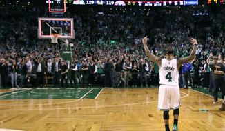 Boston Celtics guard Isaiah Thomas celebrates with fans after defeating the Washington Wizards 129-119 in a second-round NBA playoff series basketball game in Boston, Tuesday, May 2, 2017. Thomas scored 53 in the overtime win, taking a 2-0 lead in the series. (AP Photo/Charles Krupa)