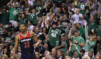 Boston Celtics fans cheer during the second quarter of a second-round NBA playoff series basketball game against the Washington Wizards in Boston, Tuesday, May 2, 2017. (AP Photo/Charles Krupa)