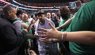 Boston Celtics guard Isaiah Thomas is congratulated by fans after a win against the Washington Wizards during a second-round NBA playoff series basketball game in Boston, Tuesday, May 2, 2017. Thomas scored 53 as the Celtics defeated the Wizards 129-119 in overtime, taking a 2-0 lead in the series. (AP Photo/Charles Krupa)