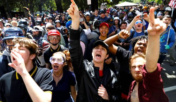 Demonstrators protest against Ann Coulter and her recent scheduled appearance on the campus of the University of California, Berkeley. (Associated Press)