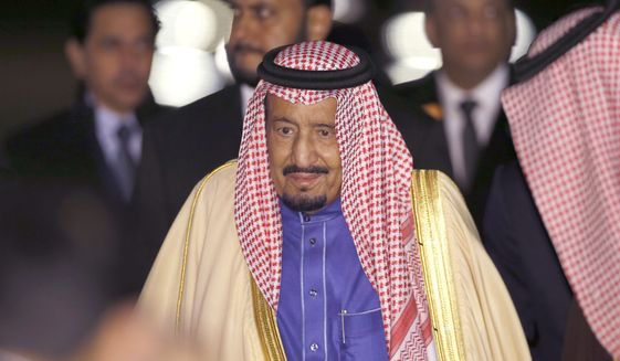Saudi King Salman walks upon his arrival at Haneda International Airport in Tokyo, March 12, 2017. (AP Photo/Shizuo Kambayashi) ** FILE **