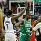 Washington Wizards guard Brandon Jennings (7) and Boston Celtics guard Terry Rozier (12) bump each other after the whistle during the second half in Game 3 of a second-round NBA playoff series basketball game, Thursday, May 4, 2017, in Washington. (AP Photo/Andrew Harnik)