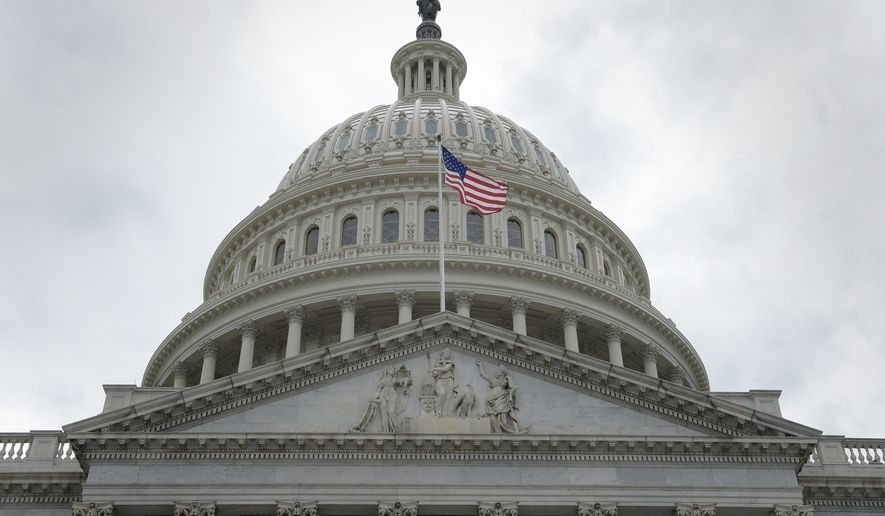 A flag flies in front of the Capitol dome on Capitol Hill in Washington, Thursday, May 4, 2017, after the Republican health care bill passed in the House. (AP Photo/Susan Walsh)
