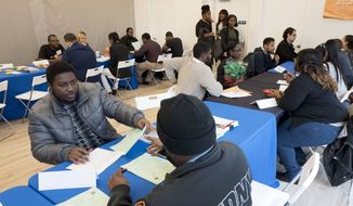 In this Tuesday, Nov. 15, 2016, file photo, Kenneth Bennett, left, talks with a recruiter from the Fire Department City of New York during a job fair hosted by the Gregory Jackson Center for Brownsville, in the Brooklyn borough of New York. (AP Photo/Mark Lennihan) ** FILE **
