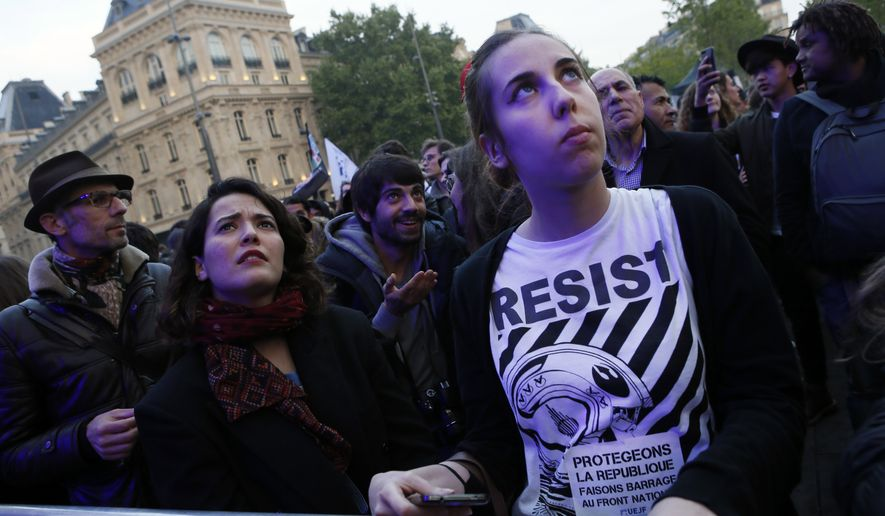 Parisians attended a concert Thursday featuring various artists opposing Marine Le Pen, who faces off in the French presidential runoff Sunday against Emmanuel Macron. (Associated Press)
