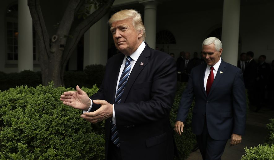 President Donald Trump, followed by Vice President Mike Pence, applauds as they arrive in the Rose Garden of the White House in Washington, Thursday, May 4, 2017, after the House pushed through a health care bill. (AP Photo/Evan Vucci) **FILE**