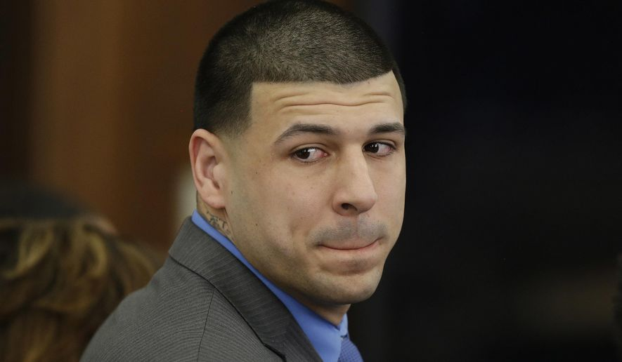 FILE - In this April 14, 2017, file pool photo, former New England Patriots tight end Aaron Hernandez turns to look in the direction of the jury as he reacts to his double murder acquittal after the sixth day of jury deliberations at Suffolk Superior Court in Boston. An investigative report, released Thursday, May 4, 2017, on the suicide of Hernandez has confirmed that he wrote a reference to a biblical passage in ink on his forehead and in blood on the wall of his prison cell. (AP Photo/Stephan Savoia, Pool)