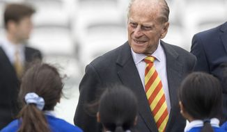 FILE - In this Wednesday, May 3, 2017 file photo Britain's Prince Philip, the Duke of Edinburgh, smiles during his visit to Lord's Cricket Ground to open the new Warner Stand, in London. Buckingham Palace said Thursday May 4, 2017 that Prince Philip will no longer carry out engagements starting this fall.  (Arthur Edward/Pool Photo via AP)