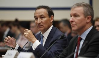 United Airlines CEO Oscar Munoz, left, accompanied by United Airlines President Scott Kirby, right, testifies on Capitol Hill in Washington, Tuesday, May 2, 2017, testifying before a House Transportation Committee oversight hearing. (AP Photo/Pablo Martinez Monsivais)