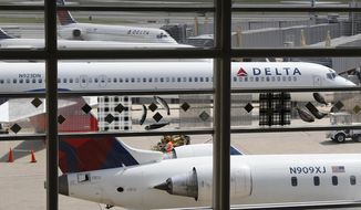 In this Monday, Aug. 8, 2016, file photo, Delta Air Lines planes are parked at Ronald Reagan Washington National Airport, in Washington. (AP Photo/Carolyn Kaster, File)