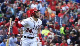 Washington Nationals' Bryce Harper tosses his bat as he flies out to center field to end the first inning of a baseball game against the Arizona Diamondbacks in Washington, Thursday, May 4, 2017. (AP Photo/Manuel Balce Ceneta)