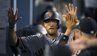 San Francisco Giants' Hunter Pence is congratulated by teammates after scoring when Buster Posey grounded out during the eighth inning of a baseball game against the Los Angeles Dodgers, Wednesday, May 3, 2017, in Los Angeles. (AP Photo/Mark J. Terrill)