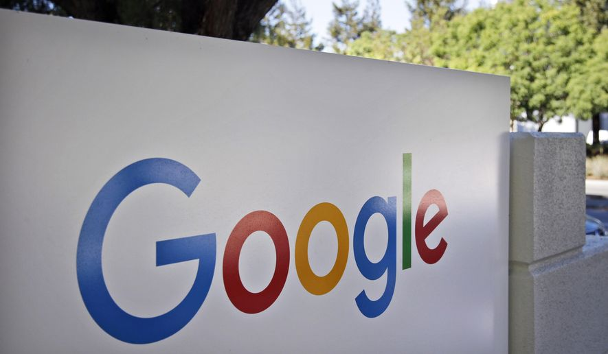FILE - This Oct. 20, 2015, file photo, shows a sign outside Google headquarters in Mountain View, Calif. Google is warning users Wednesday, May 3, 2017, to beware of a phishing scam spread by a fraudulent invitation to share a Google Doc. (AP Photo/Marcio Jose Sanchez, File)
