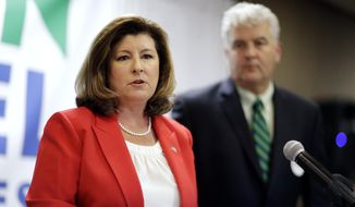 In this April 18, 2017, file photo, Republican candidate for Georgia's 6th Congressional seat Karen Handel, left, speaks at an election night watch party with husband Steve, right, in Roswell, Ga. (AP Photo/David Goldman, File)