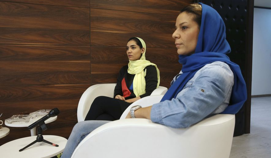 "Iranian national basketball team players Shadi Abdolvand, left, and Ayrin Artoonian attend an interview with The Associated Press in Tehran, Iran, Thursday, May 4, 2017. Basketball enthusiasts around the world said a decision to allow players to wear religious headgear in competition will encourage more people to play the sport because it gives participants the right to practice their faith and focus on playing ball. Abdolvand said basketball will change in Iran because younger players will be encouraged to ""pursue their goals."" (AP Photo/Vahid Salemi)"