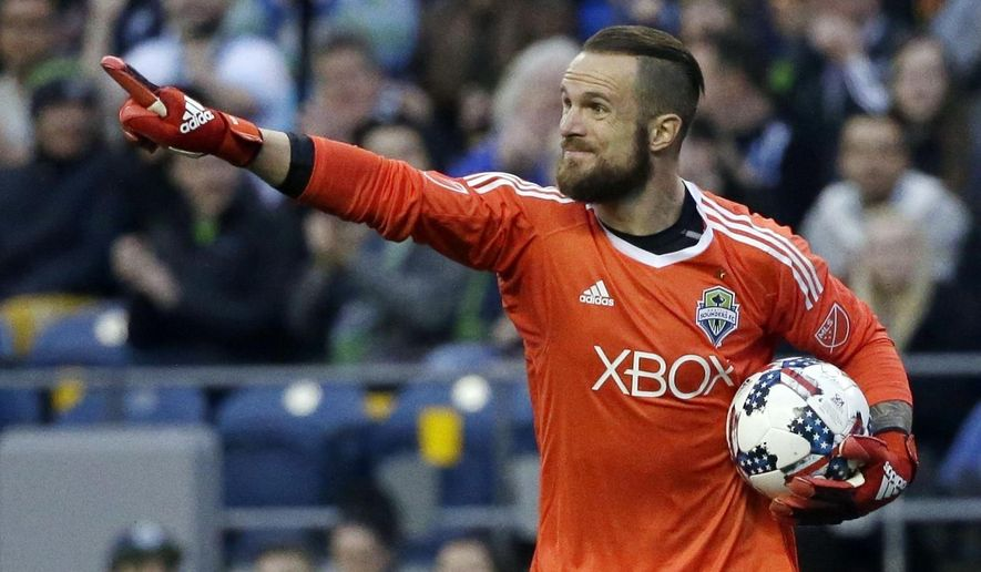 FILE - In this March 31, 2017, file photo, Seattle Sounders goalkeeper Stefan Frei directs his teammates during an MLS soccer match against Atlanta United in Seattle. Frei has plenty of memories from last December's MLS Cup. Few top his save on Toronto's Jozy Altidore that's now become iconic in Seattle. The two MLS Cup finalists from last season meet for the only time in 2017 this weekend.  (AP Photo/Ted S. Warren, File)