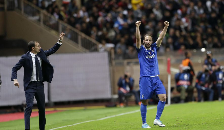 Juventus' Gonzalo Higuain, right, celebrates after scoring as Juventus head coach Massimiliano Allegri gives instructions during the Champions League semifinal first leg soccer match between Monaco and Juventus at the Louis II stadium in Monaco, Wednesday, May 3, 2017. (AP Photo/Claude Paris)