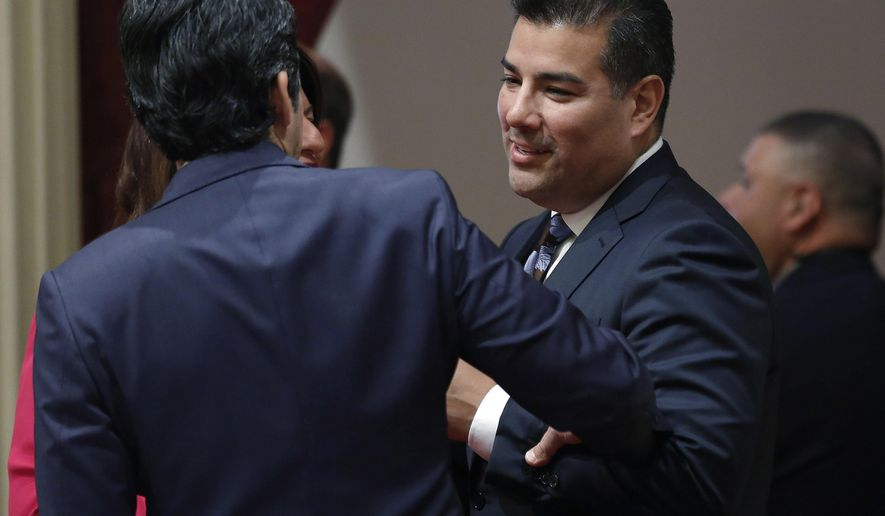Sen. Ricardo Lara, D-Bell Gardens, right, talks with Senate President Pro Tem Kevin de Leon, D-Los Angeles, at the Capitol Thursday, May 4, 2017, in Sacramento, Calif. California may hold its presidential primary elections in March after lawmakers in both chambers of the Legislature passed bills Thursday to increase the influence of the nation's largest and most diverse state. The state Senate passed a bill to move California's primary from June to the third Tuesday in March.  The bill now goes to the Assembly. (AP Photo/Rich Pedroncelli)