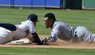 Texas Rangers' Carlos Gomez, right, slides safely in for a double ahead of the tag by Houston Astros second baseman Jose Altuve in the eighth inning of a baseball game Thursday, May 4, 2017, in Houston. (AP Photo/George Bridges)