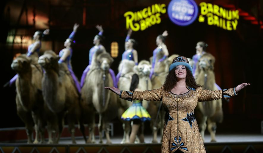 FILE- In this Jan. 14, 2017 file photo, Ringling Bros. and Barnum & Bailey Ringmaster Kristen Michelle Wilson performs Saturday, Jan. 14, 2017, in Orlando, Fla. The Ringling Bros. and Barnum & Bailey Circus will broadcast its final show on the most 21st Century of channels: Facebook Live. (AP Photo/Chris O'Meara, File)