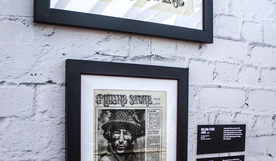 This undated image released by the Rock & Roll Hall of Fame shows the original logo, top, and the first issue of Rolling Stone magazine, part of an anniversary exhibit at the Rock & Roll Hall of Fame in Cleveland, Ohio. (Rock & Roll Hall of Fame via AP)