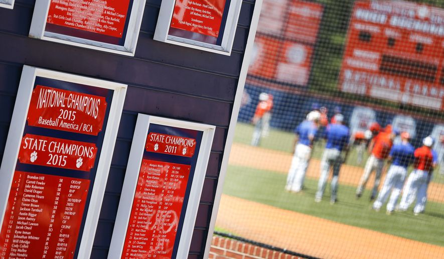 """ADVANCE FOR USE MONDAY, MAY 8, 2017 AND THEREAFTER-Plaques mark the accomplishments of the Parkview High School baseball team as they warm up before a baseball game in Lilburn, Ga., on Wednesday, April 26, 2017. Across the nation, nowhere is student-on-student sexual assault as common or as camouflaged as in boys' sports, an Associated Press investigation found. Older Parkview players in 2015 were disciplined for sexual battery, in part, after attacking younger teammates, but the district called it """"inappropriate physical contact"""" and """"misbehavior."""" (AP Photo/John Bazemore)"""